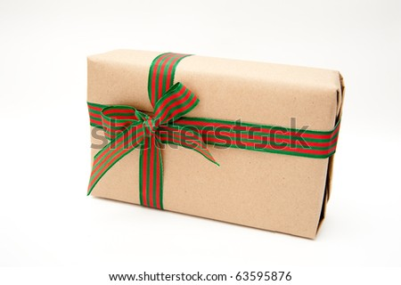 Present Wrapped in Brown Paper with a Green and Red Striped Ribbon