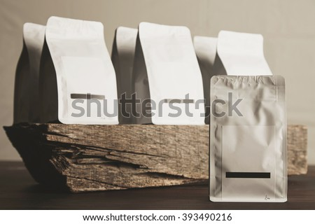 Presentation of blank sealed white packages with product inside ready for sale and deliverySmall artisan business process concept #393490216