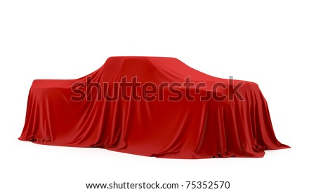 Presentation of the pickup truck. Autoshow. Car under the tissue.