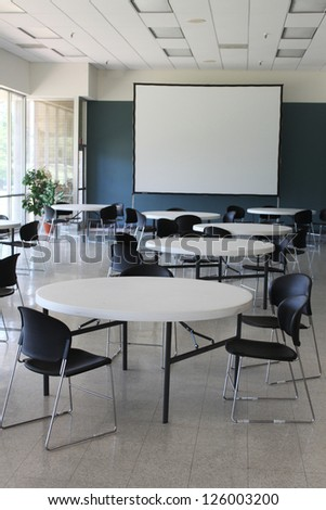 Presentation room with a large white screen