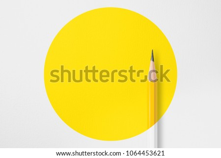 Presentation template with copy space by top view close up macro  photo of wooden yellow pencil put on texture white paper and combine with yellow circle shape.Flash light made soft light on pencil. #1064453621