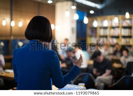 Presenter Giving Presentation at Conference with Investors and MBA Students. Speech during Workshop Teaching Business Tech. Executive Coach Training Corporate Manager. Businesswoman at Pitch Event.