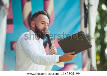 Presenter with microphone. Emcee definition is - master of ceremonies Stock photo ©