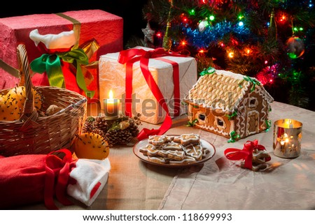 Presents and gingerbread cookies on the table on Christmas Eve