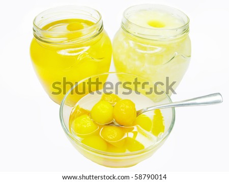 preserved papaya fruit in balls in syrup and pineapple isolated