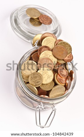 preserves jar filled with coins saved