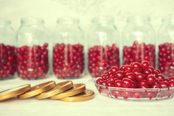 Preserving cherries in glass jars for the winter or in case of self-isolation in quarantine. Homemade fruit stocks in their own juice. Cherry compote with your own hands.
