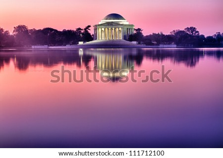 President Jefferson Memorial reflecting in the Tidal Basin at sunrise.