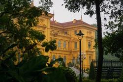 Presidential palace in Hanoi, Vietnam. A beautiful colonial yellow building