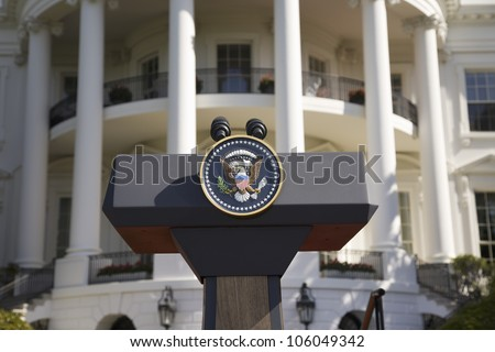Presidential Seal on podium in front of the South Portico of the White House, the Truman Balcony, in Washington, DC on May 7, 2007 - stock photo