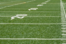 prespective view of marker lines down empty football field