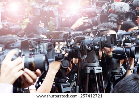 press and media camera ,video photographer on duty in public news coverage event for reporter and mass media communication