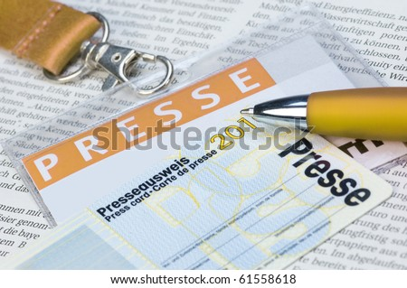 Press card on a newspaper