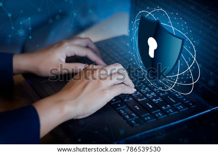 Press enter button on the keyboard computer Shield cyber Key lock security system abstract technology world digital link cyber security on hi tech Dark blue background, lock finger Keyboard
