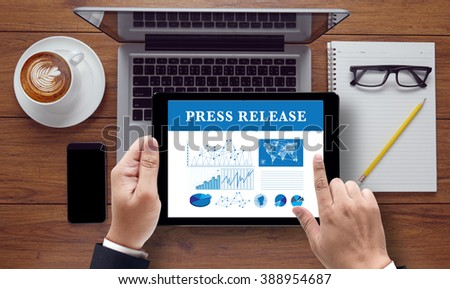 Press Release  concept on the tablet pc screen held by businessman hands, top view #388954687