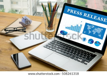 Press Release Laptop on table. Warm tone