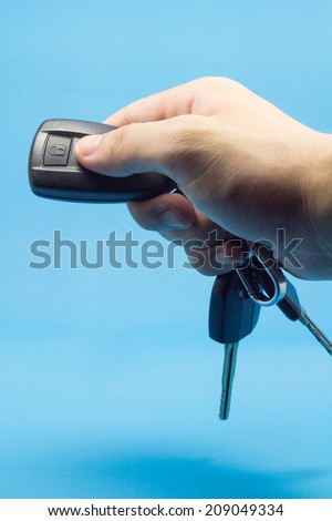 Press the remote control car with blue background.