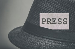 Press word on a label of the vintage hat