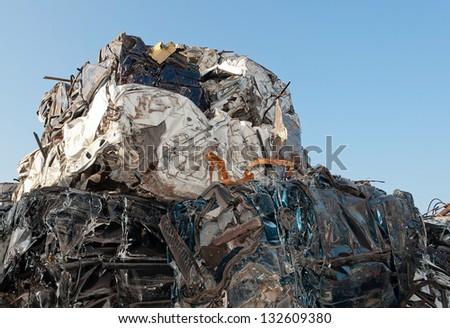 pressed cars at a car wrecker