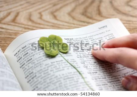 Pressed four-leaf clover