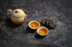 pressed pu-erh Chinese tea, cups of tea and teapot. Asia culture design concept. tea ceremony, Chinese or japanese traditions. copy space