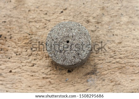 Pressed sunflower seeds into a round briquette. It is used as feed for animals, birds and fish. One of the feed ingredients. Copy space