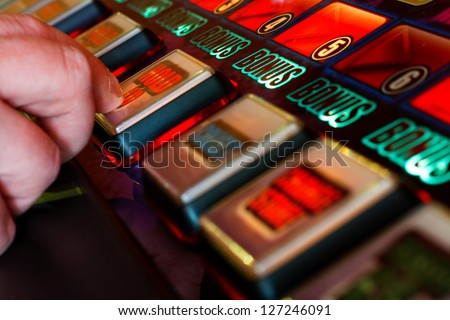 pressing the hold button on slot machine