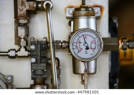 Pressure gauge in oil and gas production process for monitor condition, The gauge for measure in industry job, Industry background and close up gauge , gauge for measure pressure in the process. #447981505