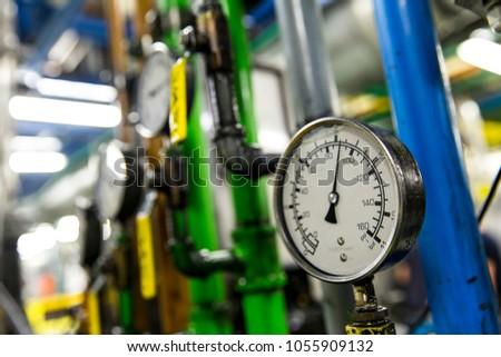 Pressure gauge, measuring instrument close up. Hydraulic pressure gauges installed on hydraulic equipment
