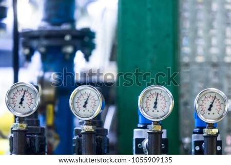 Pressure gauge, measuring instrument close up. Hydraulic pressure gauges installed on hydraulic equipment #1055909135