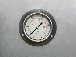 Pressure gauge mounted on stainless steel.blur background selective focus.