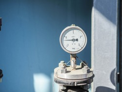 Pressure gauge of measuring instrument close up in industry zone at power plant with closed up
