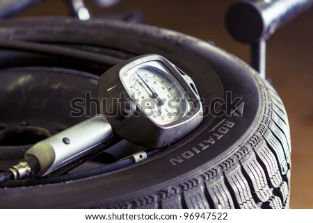 Pressure meter on a flat tire