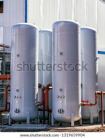 Pressure vessel of the storage tanks. A pressure vessel constructed of a vertical steel cylinder (LPG Storage, In the United States ASME Boiler and Pressure Vessel Code, Ad Merkblatt design). #1319659904