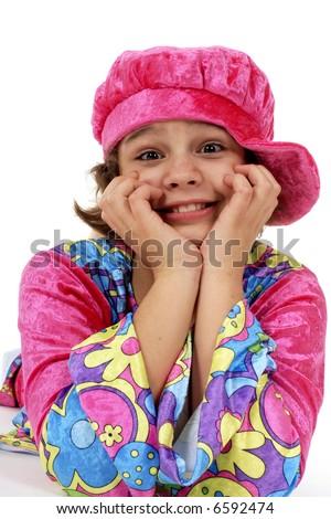 Preteen girl in bright seventies garb. - stock photo