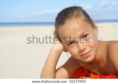 Preteen girl on a beach
