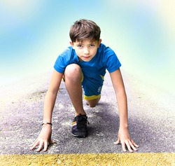 preteen handsome boy in sport clothes and shoes prepare to have running event contest