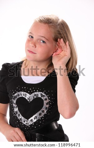 Preteen 10 year old female girl listening or hearing isolated against a white background.