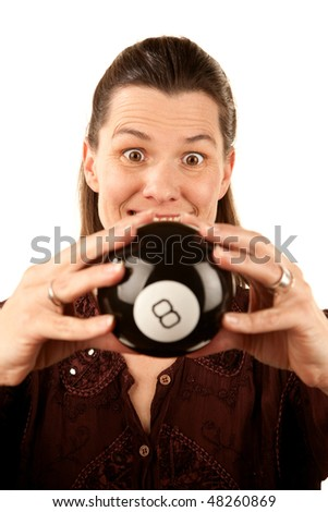 Pretty adult woman reading the future from a toy eight ball