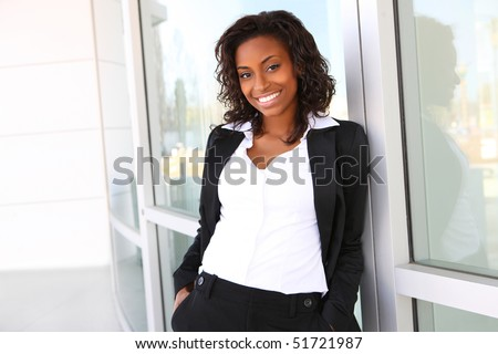 Pretty african american business woman at office building