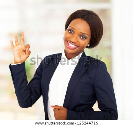 pretty african american businesswoman giving ok hand sign - stock photo