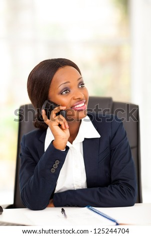 pretty african american office worker talking on cell phone