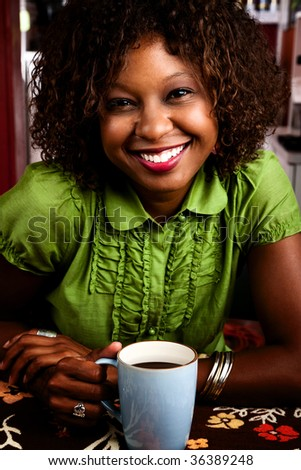 Pretty African American Woman in Bright Green Blouse