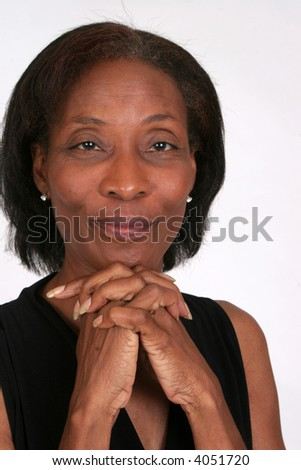 Pretty African American woman with her hands folded under her chin
