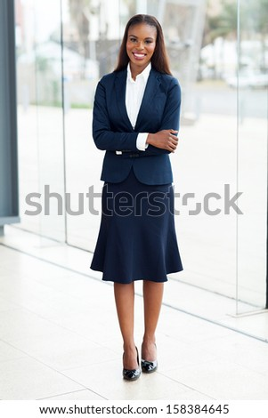 pretty african office worker with arms crossed