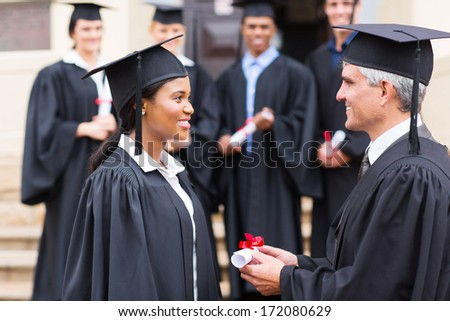 pretty african student receiving certificate from dean