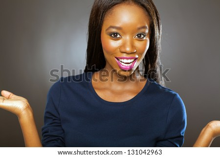 pretty african woman looking surprised