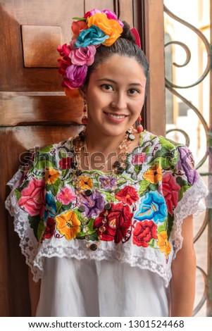 Pretty and colorful Mayan girl in Yucatan Young smiling girl inviting tourism to visit Merida in the Yucatan peninsula