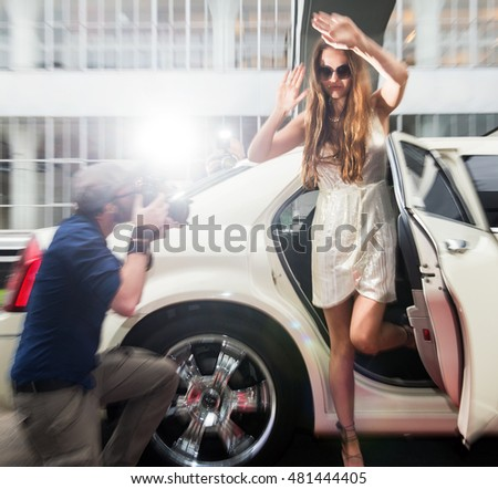 Pretty and young celebrity, rushing out of a limousine, trying to escape multiple photographers, shielding her identity with a pair of large sunglasses and her hands. Slight motion blur.