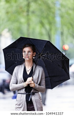 Pretty and young woman with umbrella